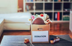 Toys donations box. On the table Stock Photo