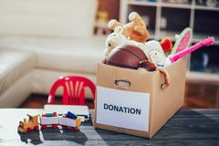 Toys donations box. On the table Stock Images