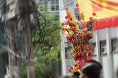 Toys in dragon and drum on stick at shop pole in chinese new yea stock photography