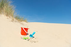 Toys in the dunes. At the coast Royalty Free Stock Images