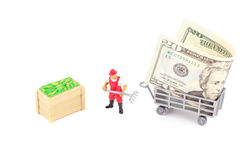 Toys: farmer and trailer with dollar inside Royalty Free Stock Image