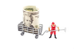 Toys: farmer and trailer with dollar inside Stock Photo