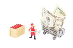 Toys: farmer and trailer with dollar inside Stock Photography