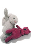 Toys Fighting. Rabbit and cat depicting agression Royalty Free Stock Photos