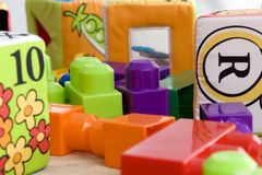 Toys on the floor 1. Building blocks and counting blocks on the floor Stock Images