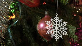 Toys and garlands on christmas tree stock video