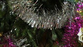 Toys and garlands on christmas tree stock footage