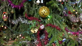 Toys and garlands on  christmas tree stock video footage