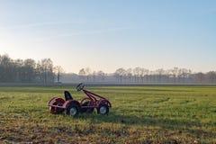Toys go-kart parked on farmland. Achterhoek. Gelderland. The Net Stock Photography
