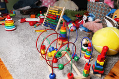 Toys in kids room on the floor. Many different toys in kids room on the floor stock photos
