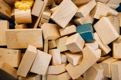 Toys in kindergarten. Chaotically scattered wooden blocks royalty free stock image