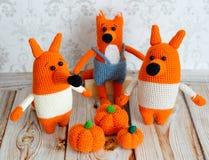 Amigurumi toys. Foxes family Stock Photos