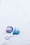 Toys left behind on a snowy ground Stock Photos