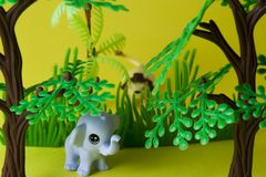 Toys with lion and elephant in natural environment. Lion hunting royalty free stock images