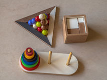 Toys logic. Logic toys made of wood - Hanoy Tower, Pyramid of balls and Magic Cube Royalty Free Stock Photos