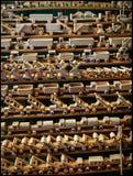 Toys made of wood. Handmade listed on the shelf trucks, tractors, windmills, excavators stock photo