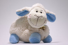 Toys. Milan fluffy white lamb with blue legs Royalty Free Stock Images