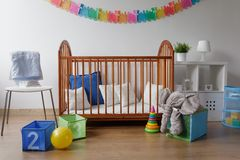 Toys in modern baby bedroom Stock Image