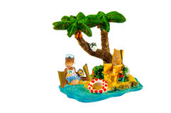 Toys Momkey Rest under a palm tree Royalty Free Stock Photography