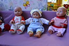 Toys in my kindergarten. Old toy doll dressed in the same old clothes. The atmosphere is depressing Royalty Free Stock Images