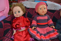 Toys in my kindergarten. Old toy doll dressed in the same old clothes. The atmosphere is depressing Stock Photography