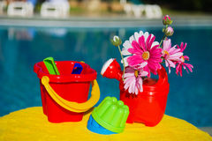 Toys near swimming pool Stock Image