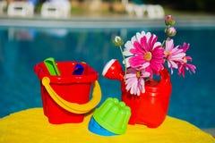 Toys near swimming pool Stock Image
