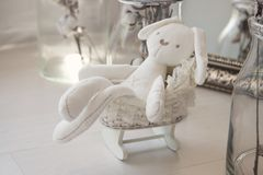 Toys newborns. White rabbit in a little buggy royalty free stock photos