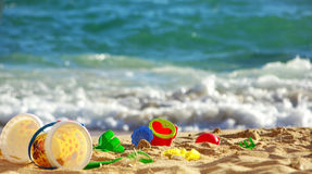 Toys  next to the sea. Stock Photos