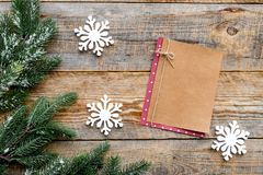 Toys and notebook for new year celebration with fur tree branches on wooden background top veiw mockup Royalty Free Stock Photos