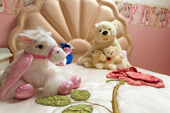 Toys on pink bed Stock Image