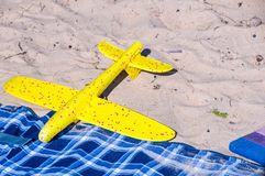 Toys plane on sand. Holiday and vacation stock image