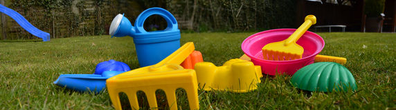 Toys playground sand molds. Green meadow Royalty Free Stock Image