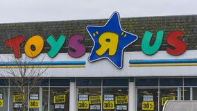 Toys R Us Logo with Closing Down Signs. Gloucester, England - March 13, 2018: Toys R Us Logo with Closing Down Signs, horizontal photography royalty free stock image