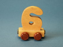 Toys, rating train. Part of wooden rating train on blue background, toys Royalty Free Stock Images