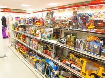 Toys for sale in a store. The toy department in T K Max store in Kempston, near Bedford, United Kingdom. The new toys are displayed on shelves low down for Stock Images