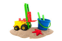 Toys in the sand Stock Image