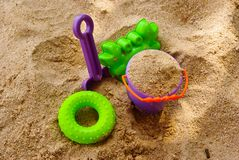 Toys in the sand Stock Photography