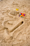 Toys on the sand Royalty Free Stock Image