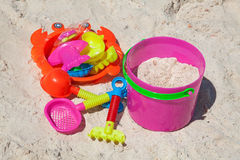 Toys in sand Royalty Free Stock Photo