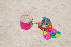 Toys in sand Royalty Free Stock Photography