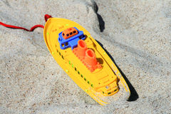 Toys on sand. Vessel in the sand - a toy for children Royalty Free Stock Photos