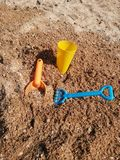 Toys on the sand royalty free stock photography