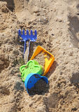 Toys in sand Stock Photography