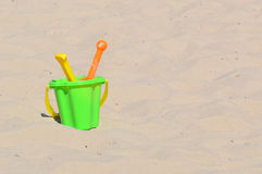 Toys in a sand Stock Image