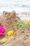 Toys and sand. Royalty Free Stock Photos