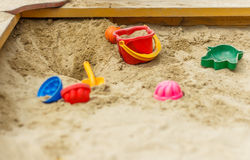 Toys in the sandbox. Children's toys in the sandbox Royalty Free Stock Photo