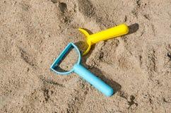 Toys in a sandbox closeup Stock Photo