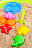 Toys in sandbox Royalty Free Stock Image