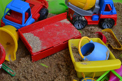 Toys in the sandbox. Dirty color plastic toys in the sandbox Stock Photo